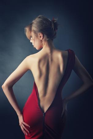 Beautiful girl back  Dress unbuttoned to the buttocks Stock Photo - 17823900