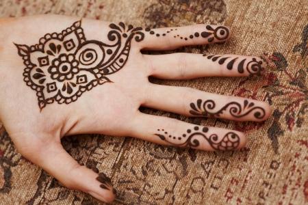 Henna art on woman s hand