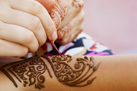 Henna art on woman s hand photo