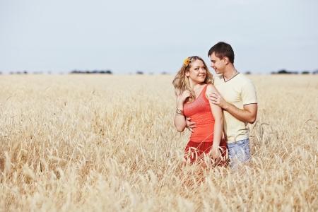 Laughing children in wheat field Stok Fotoğraf