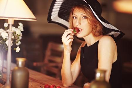 Beautiful woman with strawberry