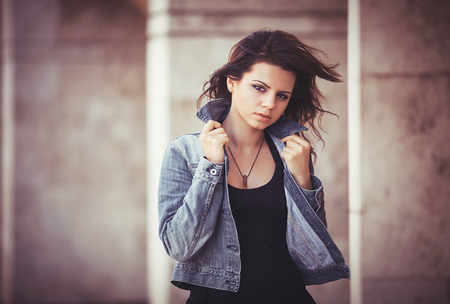 Beautiful girl in black skirt holding hands in jeans jacket Stok Fotoğraf - 29685114