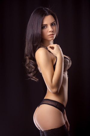 On dark background girl in lingerie