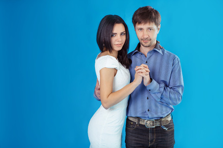 In light studio married couple poses for �photograph