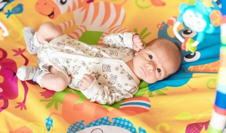 Baby boy in a rocking cradle at home Stock Photo