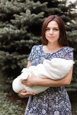 Mom with a newborn baby in the street Stock Photo