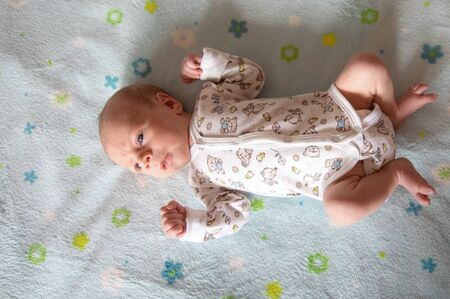 Lying on the bed sheet baby at home Stok Fotoğraf - 131868953
