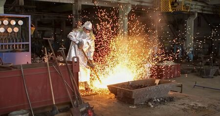 red-hot molten steel in a iron and steel enterprise production scene 写真素材