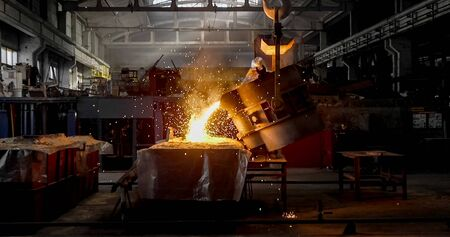 Smelting metal in a metallurgical plant. Liquid iron in the ladle in metallurgy factory.
