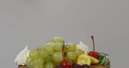 Cheesecake with grapes and powdered sugar. Shallow dof. Stock Photo