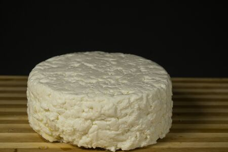 Italian soft cheese made from cow's milk, On a black background
