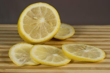 Citrus fruits- lemon, on the wooden blackboard, On a blue background Standard-Bild