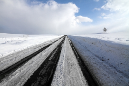 The asphalted road covered with snow   photo