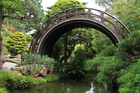 spiritual architecture: Arch bridge in an asian garden  Stock Photo
