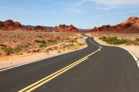 Winding road through desert photo