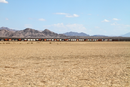 goods train: Freight Train in a desert Landscape