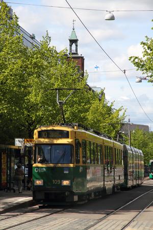Helsinki, Finland - JUNE 4, 2015: Helsinki tram. Street tram runs in Helsinki city centre.  The Helsinki system is one of the oldest electrified tram networks in the world.