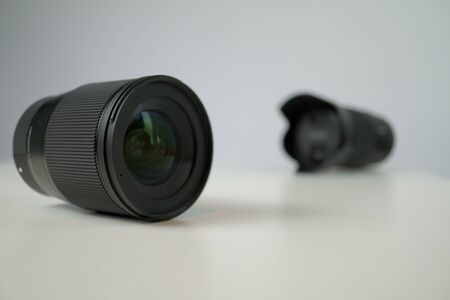 dslr camera lense, close-up view on table with smooth background