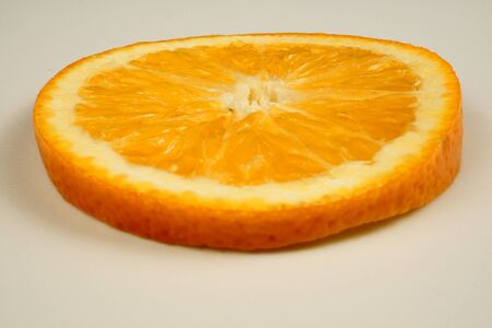 Fresh sliced oranges and on white background Фото со стока - 130801414