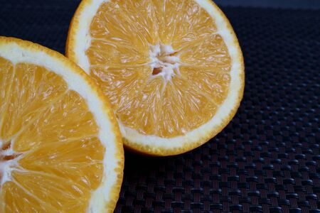 Fresh sliced oranges and on gray background