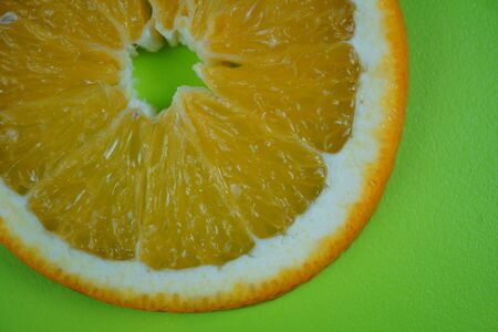 Fresh sliced oranges and on green background