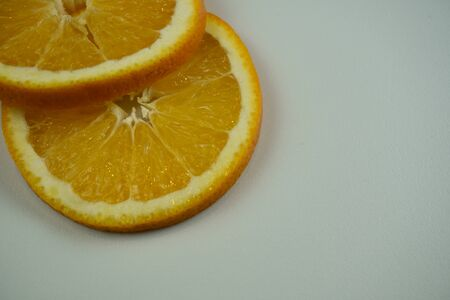 Fresh sliced oranges and on white background Фото со стока - 130801425