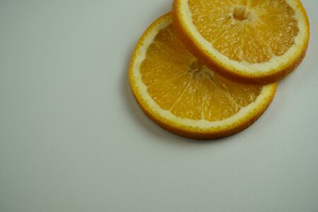 Fresh sliced oranges and on white background Фото со стока - 130801426