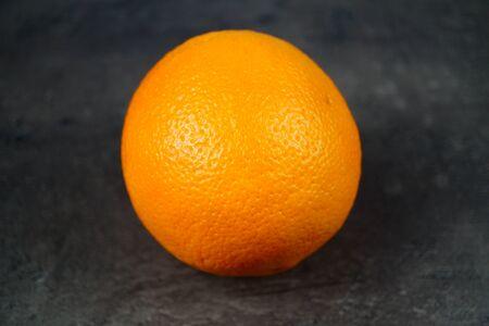 Orange isolated on dark background. Close-up photo