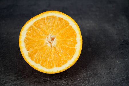 Fresh sliced oranges and on gray background Фото со стока - 130801456
