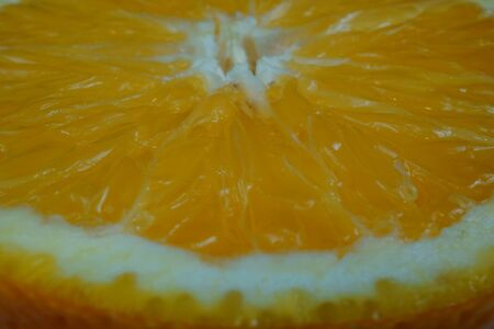Macro photo of orange slice on white background