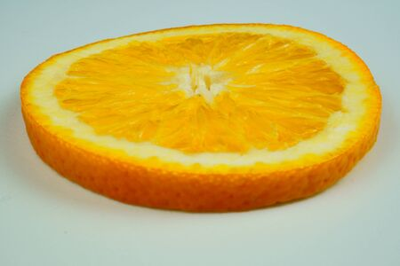 Fresh sliced oranges and on white background Фото со стока