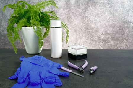 Set of manicure or pedicure tools on grey background