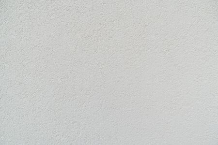 white cement wall, texture stone concrete,rock plastered stucco wall, hand painted flat facade.