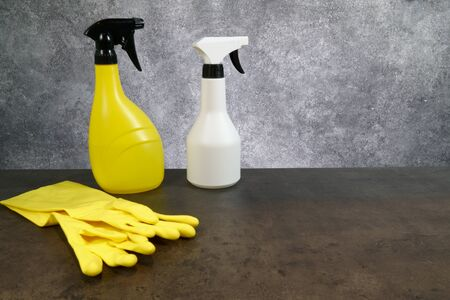 Set of cleaning supplies on grey background