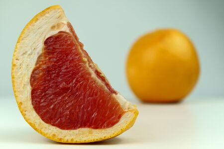 Grapefruit with grapefruit slice isolated on white background close up.