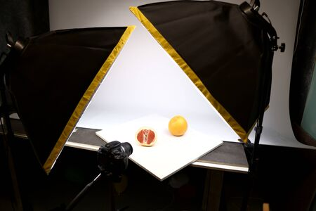 Home-made photo studio with LED light and diffusers. take pictures of grapefruit