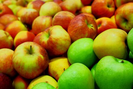 A wide variety of fresh, ecological apples at the store counter.