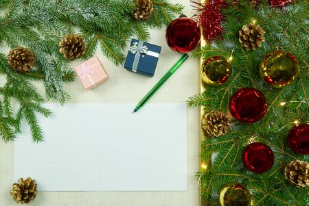 Christmas letter writing on a natural linen bedspread. Eco Christmas is always in fashion. Can be used as postcards, backgrounds, wallpapers, posters ... Christmas composition flat lay with Mockup.