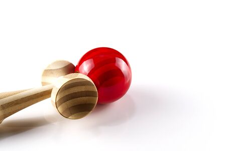 Kendama japanese wooden toy on isolated on white. Wood toy with red bal.