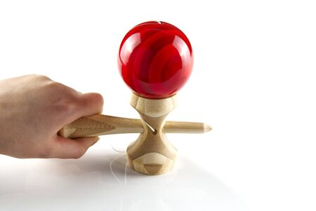Kendama japanese wooden toy on isolated on white. Wood toy with red bal. Reklamní fotografie