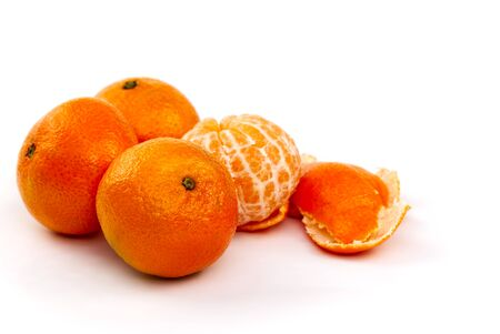 peeled mandarin tangerine clementine segments isolated on white background