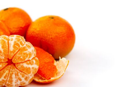 peeled mandarin tangerine clementine segments isolated on white background.
