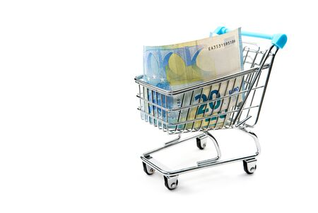Grocery cart with euro bills isolated on white. shopping, loan, money saving, pension, investments concept.