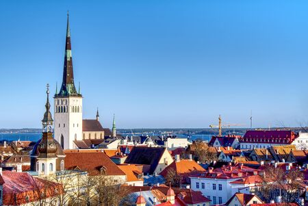 Overview of old city, Tallinn in Estonia taken from the overlook in Toompea showing the town walls and churches. HDR shoot