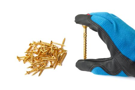 Men hand in glove holding yellow zinc torx screw, isolated on white 写真素材