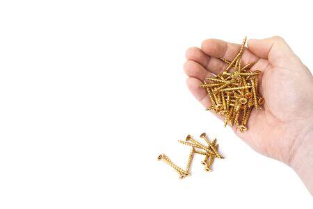 A male hand spills out yellow zinc torx screws.