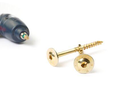 Gold torx screw isolated on white. Yellow zinc chipboard screw Torx, , full thread close up