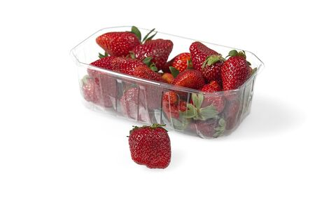 Plastic tray container full of fresh organic strawberries. close - up.