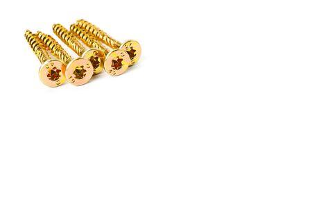 Torx yellow zinc head screws. Gold screws scattered randomly on a white background. 写真素材