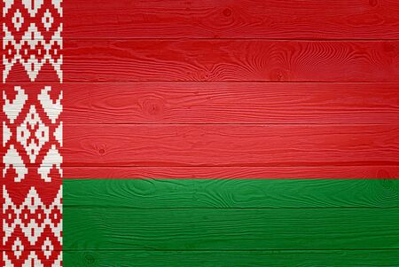 Belarus flag painted on old wood plank background. Brushed natural light knotted wooden planks board texture. Wooden texture background flag of Belarus